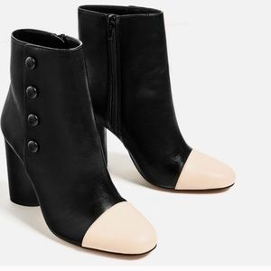 Leather button ankle boots w contrasting toe